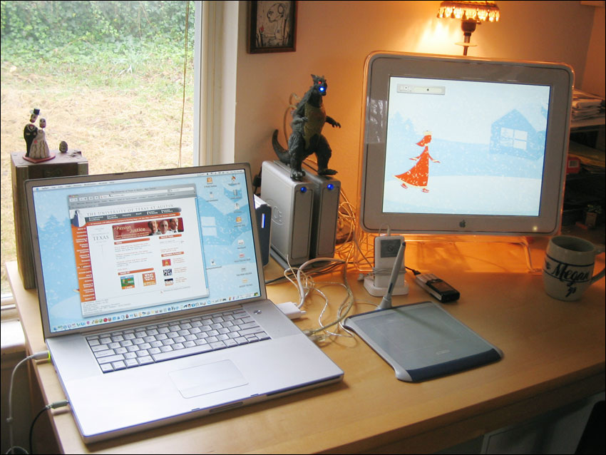 laptop and mac computer in use